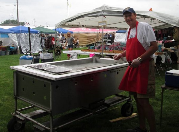 Larry frying hamburgers